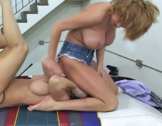 Titfight  buxom babes take turns smothering each other with their huge lustful tits. Buxom Babes take turns smothering each other with their huge libidinous boobs